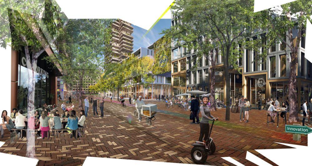 Impressie van het gebied rond station Laan van NOI, met rechts het station en links nieuwbouw op de plek waar nu het oude ministerie van Sociale Zaken staat.